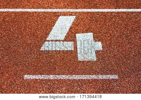 Start number four at cinder track of track and field running track