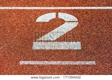 Start number two at cinder track of track and field running track