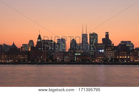 Bund waterfront sunset cityscape in Shanghai China