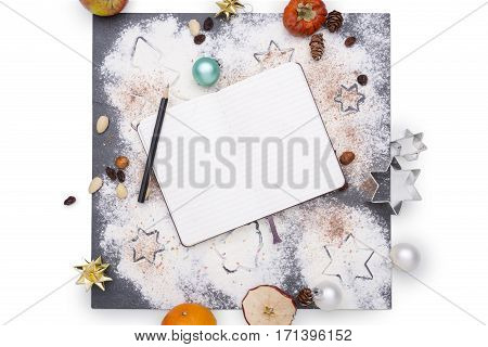 Christmas decoration with notebook on a plate of slate
