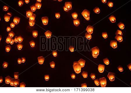 Lanterns in the night sky at the 2017 Pingxi Sky Lantern Festival in Taiwan, the Chinese text on them says fuwu, which means service