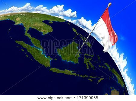 Indonesia national flag marking the country location on world map. 3D rendering, parts of this image furnished by NASA