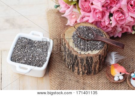 Chia seeds for health on wood background