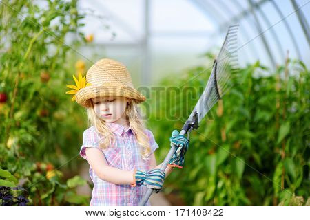 Adorable Little Girl Wearing Straw Hat Holding Garden Tools