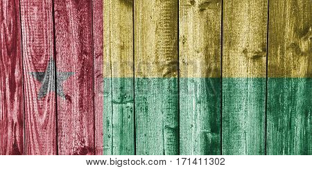 Colorful and crisp image of flag of Guinea-Bissau on weathered wood