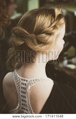 modern loose  braided woman hair portrait back view