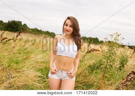 a cute girl enjoying nature in a field