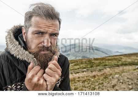 Bearded Man, Brutal Caucasian Hipster With Moustache Cold On Mountain