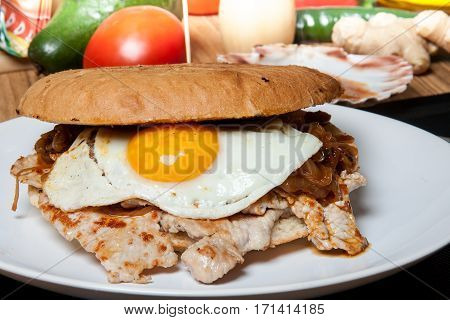 Chilean sandwich with egg chicken and onion.