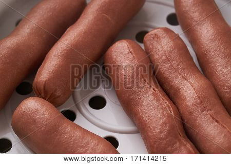Close up photo of Steamed sausage in steam cooker