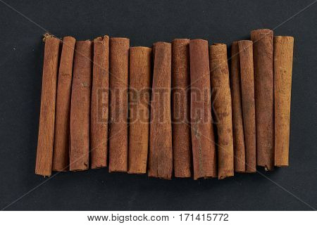 Cinnamon sticks on dark background top view