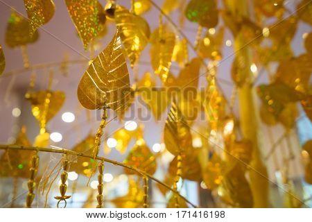 Gold Pho Leaves Hanging On Golden Tree