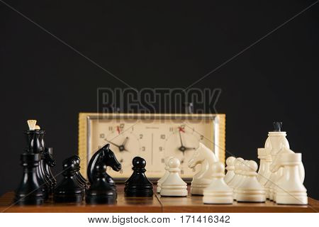 Close up of quick chess with timer on dark background.