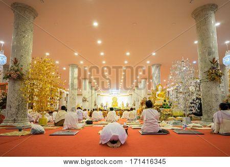 CHIANG RAI, THAILAND - FEBRUARY 4: Thai people pray at Buddha image inside of church at Wat Thamphajom temple in Chiang Rai Thailand on Febrauray 4 2017.