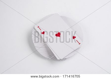 Close up of pocker cards poker game with ace of hearts on white background