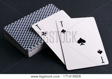 Close up pocker cards deck with two aces on dark background