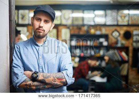 Self-employed tattoo master in his salon