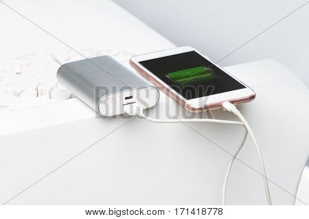 Smartphone And Powerbank. S A Symbol Of Mobile Energy And Electr