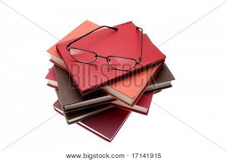 Reading glasses on pile of books