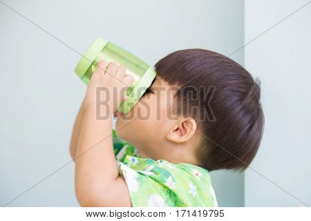 thirsty 3 years kid drinking milk from cup poster