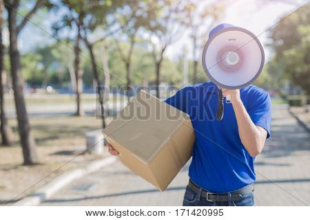 deliveryman hold box and take megaphone asian
