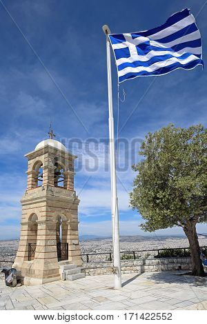 Bell Tower Greek Flag and Olive Tree at Top of Mount Lycabettos in Athens