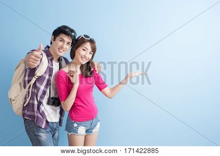 young couple go to travel and show something
