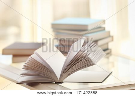 Open new book on table