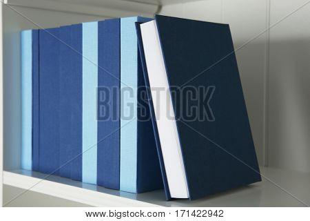 Set of books on shelf, closeup