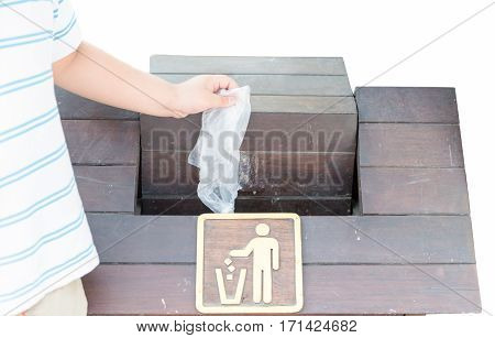 Hand boy throwing plastic bag into bin isolated on white background concept of environmental protection