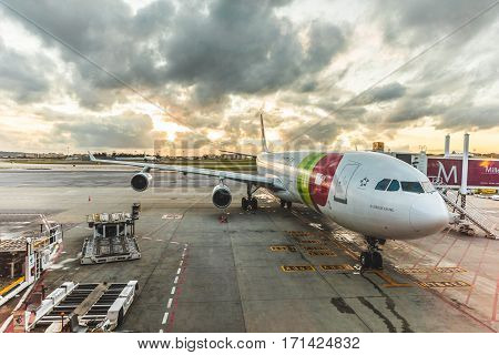 LISBON PORTUGAL - FEBRUARY 10 2017: TAP Portugal Airbus A340 at Lisbon airport boarding passengers before take off at sunet. TAP Portugal is the flag carrier airline of Portugal