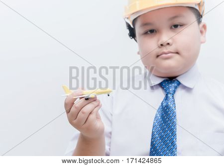 Airplane In Hand Young Engineer Pilot On White Background