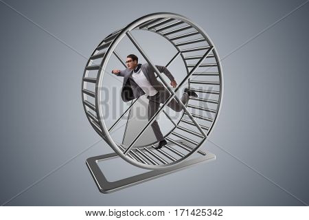Businessman running on hamster wheel