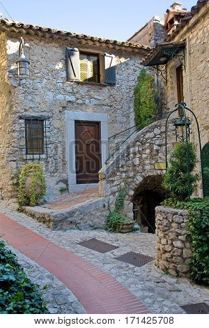 Rustic home in the mountain-top town of Eze, France. Stone buildings and narrow walkways everywhere.