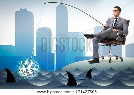 Businessman fishing out dollars from water
