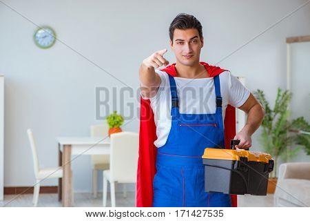 Super hero repairman working at home