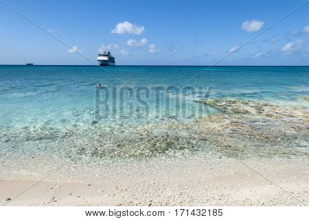 Transparent waters of Seven Mile Beach of Grand Cayman island (Cayman Islands).
