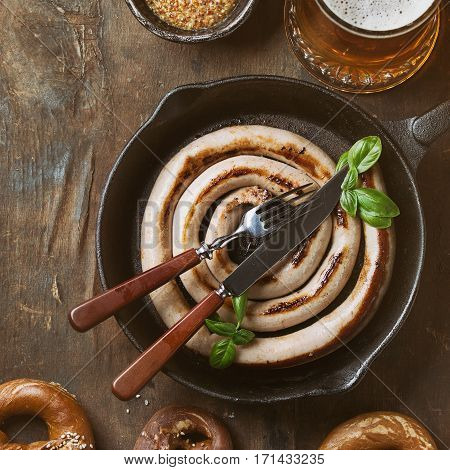 Lager Beer With Sausage And Pretzels