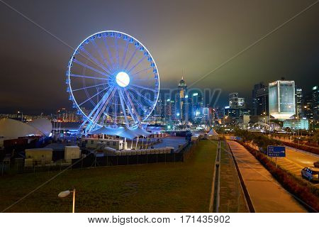 HONG KONG - CIRCA NOVEMBER, 2016: Ferris Wheel in Hong Kong at night. The Hong Kong Observation Wheel is located in Central, Hong Kong.
