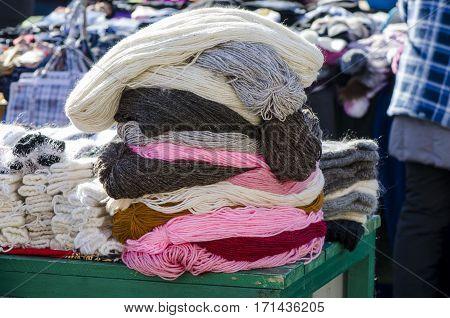 Skeins of yarn stack at a yarn street shop