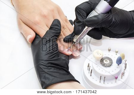 The process of women's manicure in a beauty salon