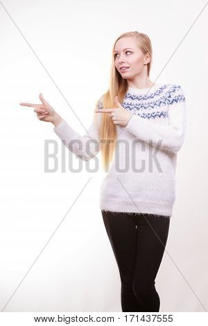 Teenage Blonde Woman Pointing At Copyspace