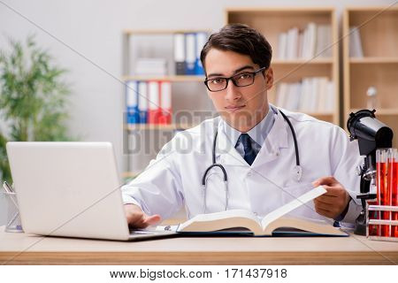Young doctor studying medical education