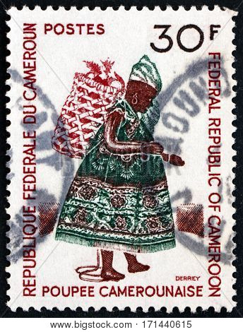 CAMEROON - CIRCA 1970: a stamp printed in Cameroon shows Doll with basket on back Cameroun puppet circa 1970
