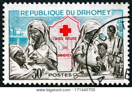 DAHOMEY - CIRCA 1962: a stamp printed in Dahomey shows Red cross nurses and map of Dahomey circa 1962