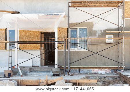 Construction or repair of the rural house with insulation eaves windows garagechimney roofing fixing facadeplastering and white walls