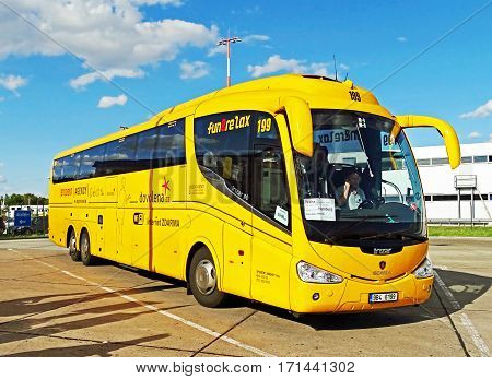 Schoenefeld, Germany - July 26, 2015: A long-distance bus of the Czech company STUDENT AGENCY waiting at the bus station of the airport Berlin-Schoenefeld (SXF) to departure to Hamburg.