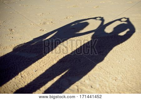Silhouettes Of Couple Or Two Lovers Photography Together, Shadow On The Ground, Woman Gesture A Hear
