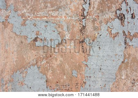 Finishing gray red plaster concrete structure cement background. The cracks on the wall paint shabby
