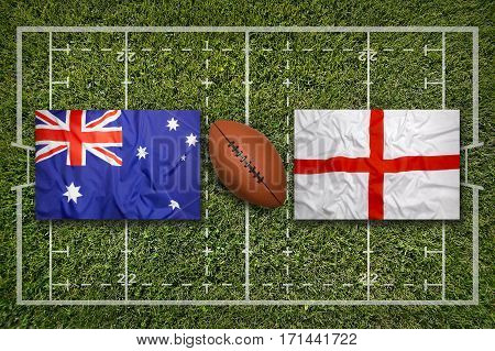 Australia vs. England flags on green rugby field, 3 D illustration